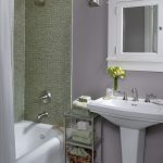 Lavender Bathroom Bathroom Storage Floral Arrangement Green Tile Lavender Walls Medicine Cabinet Pedestal Sink Shower Tub