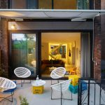 Modern Awning Brick Wall Colored Milk Crates Curtain Exterior Lighting Large Window Patio Pop Of Color Modern Furniture