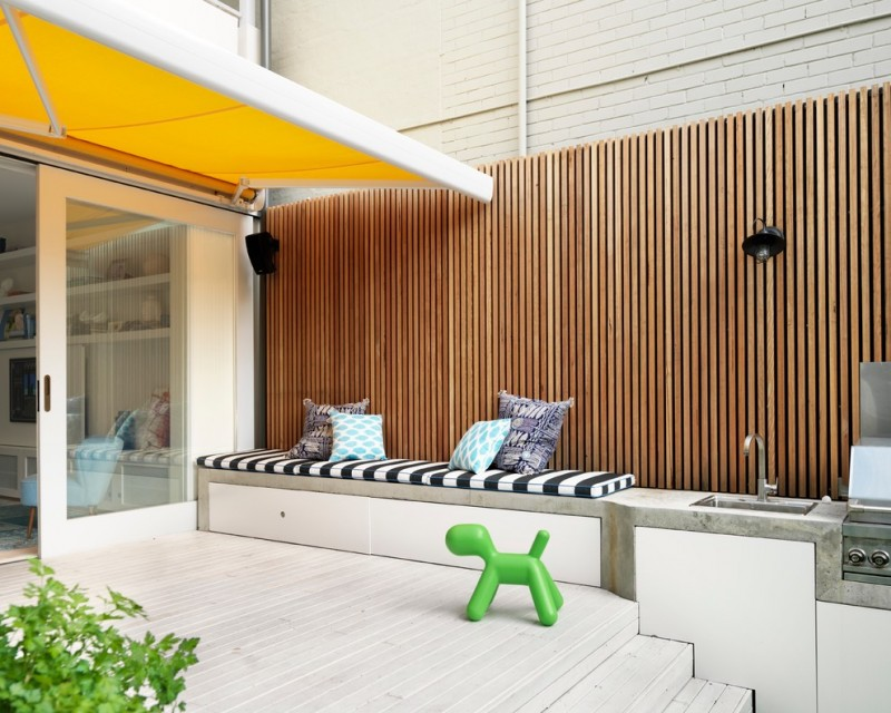 modern awning built in outdoor furniture fence outdoor deck outdoor kitchen seat cushions sink sliding glass doors yellow sunshade
