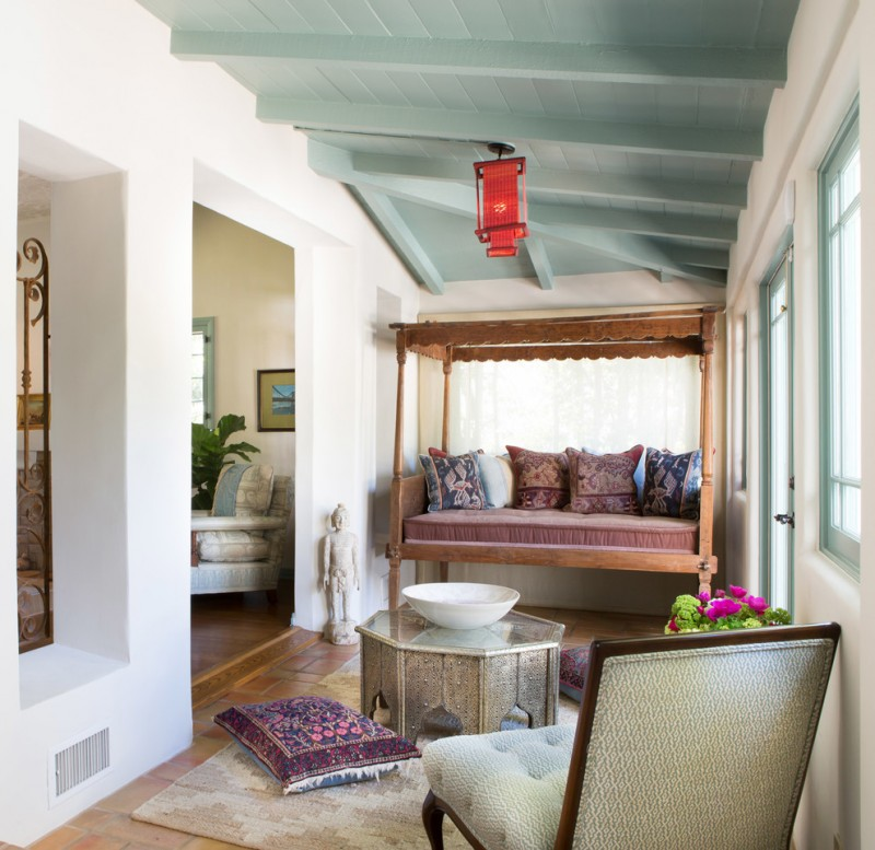 moroccan coffee table bed swing purple moroccan floor pillows chair windows white wall wood floor tosca ceiling white bowl