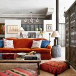 Moroccan Coffee Table Textured Rug Orange Sofa Morrican Floor Pillows Morrrocan Style Barrier Table Lamp Patterned Pillows