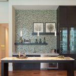 Mosaic Tiled Backsplash Onyx Countertop Shaker Cabinet Glass Front Cabinet Floating Shelf High Ceiling Pendant Lights Open Island