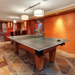 Pool Table Area Stone Wall Stone Floor Slate Tile Bar Pendant Lights Drop Down Screen Wine Cellar High Chair Wall Decoration