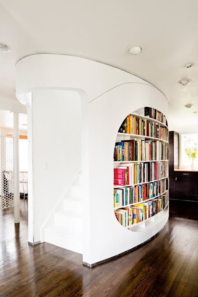 recessed lights wooden floor curved wall curved library bookcase staicase