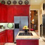 Red Cabinets Beige Stone Floor Beige Tile Backsplash Cooktop Double Kitchen Sink Fruit Bowl Granite Countertop Kitchen Island Open Shelves Wall Decor