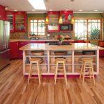 Red Cabinets Bookshelves Colorful Kitchen Cookbook Storage Glass Cabinets Green Wall Kitchen Island Kitchen Island Storage Marble Countertop Patterned Tile Backsplash Barstools