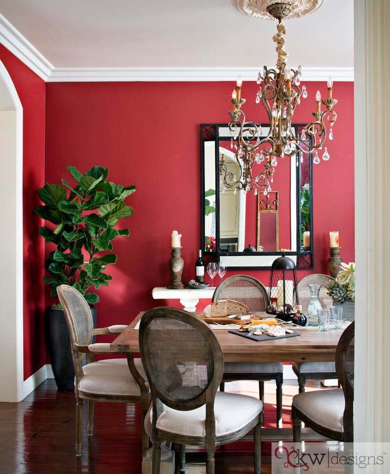 red dining room chairs chandelier dining table and chairs mirror red walls rustic chairs indoor plant wood floor
