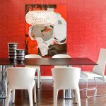 Red Dining Room Pearls Chandelier White Chairs Large Wooden Brown Table With Silver Chairs Red Artwork Wood Floor