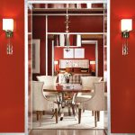 Red Dining Room Wall Sconces Metalic Chandelier White Chairs Area Rug Round Dining Silver Legs Table Bed Headboard