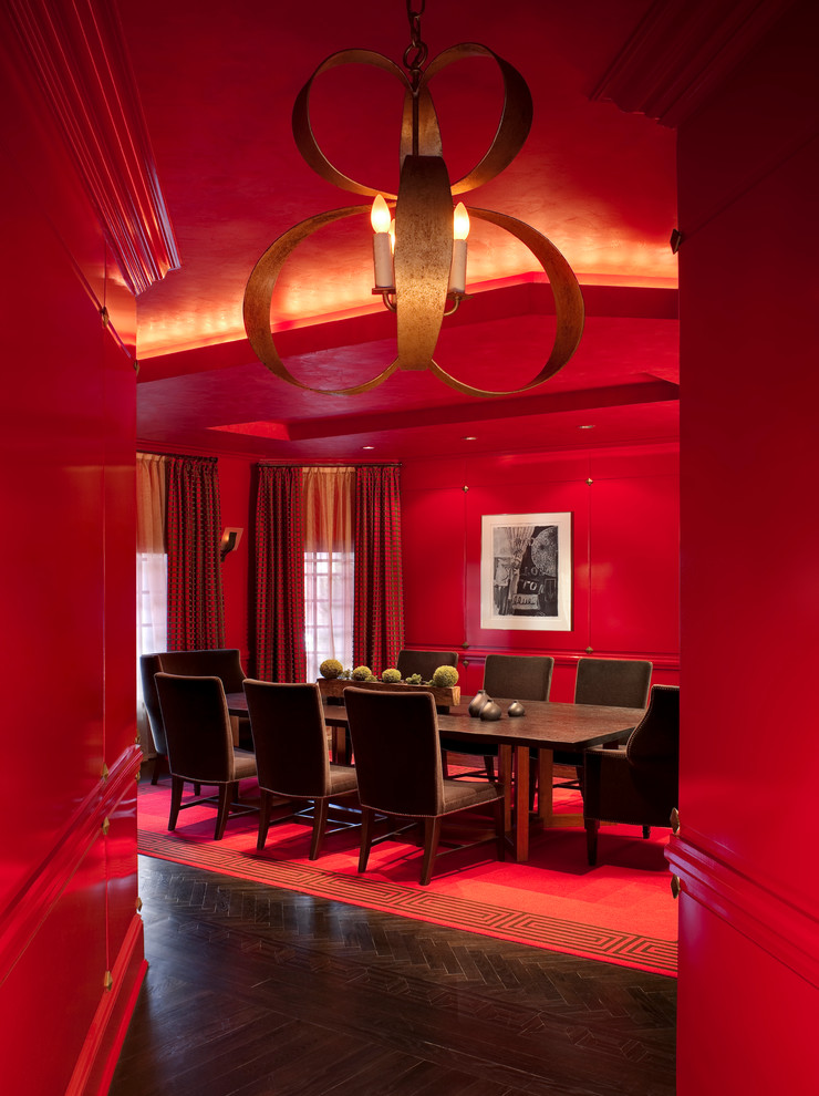 red dining room wood floor red wall and ceiling chandelier red curtains pink valances brown dining table and chairs artwork