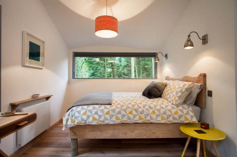 retro bedroom orange chandelier traditional wood furniture wall sconces sliding glass windows yellow round table artwork