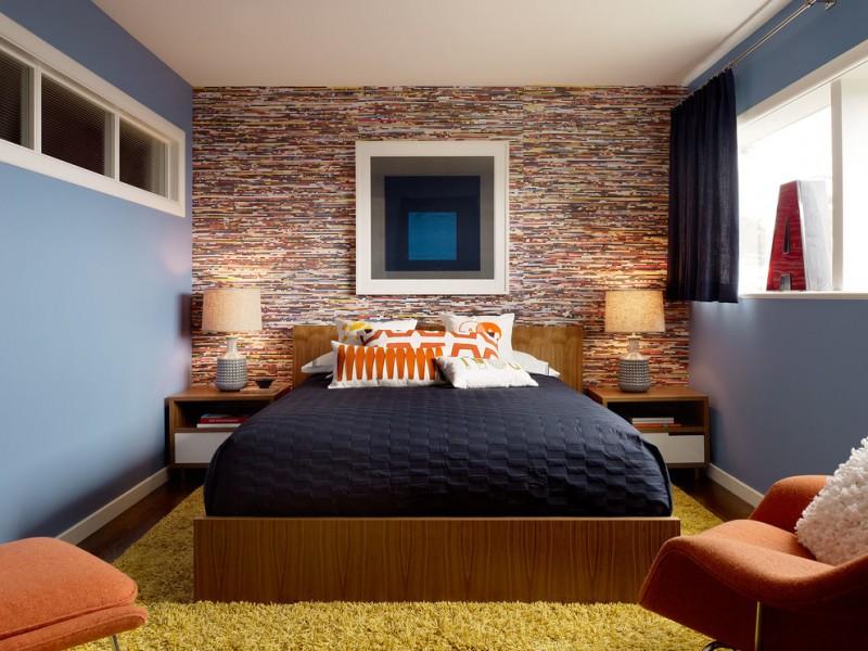 retro bedroom yellow rug black bedding orange armchairs colorful wall artwork wood bed wood nighstands window black curtain