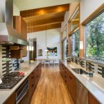 Sloped Ceiling Black And White Backsplash Black And White Tile Exposed Wood Beams Galley Style Kitchen Gray Countertop