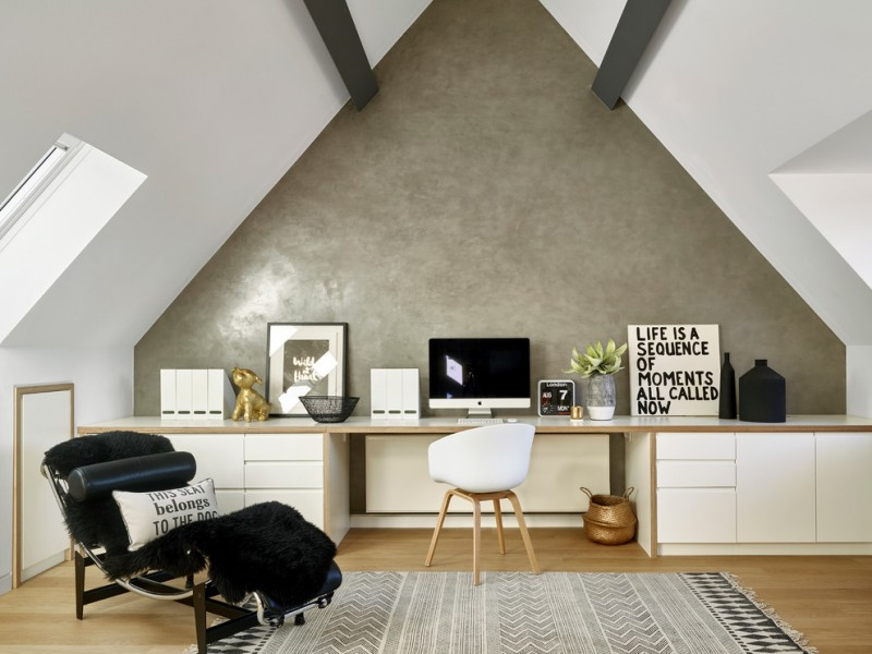 sloped ceiling small ceiling glass windows white office cabinet white chair black chair patterned rug wood flooring indoor plant