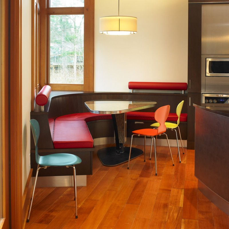 triangle dining table banquette breakfast nook colorful accent drum pendant wood flooring wood molding windows lighting