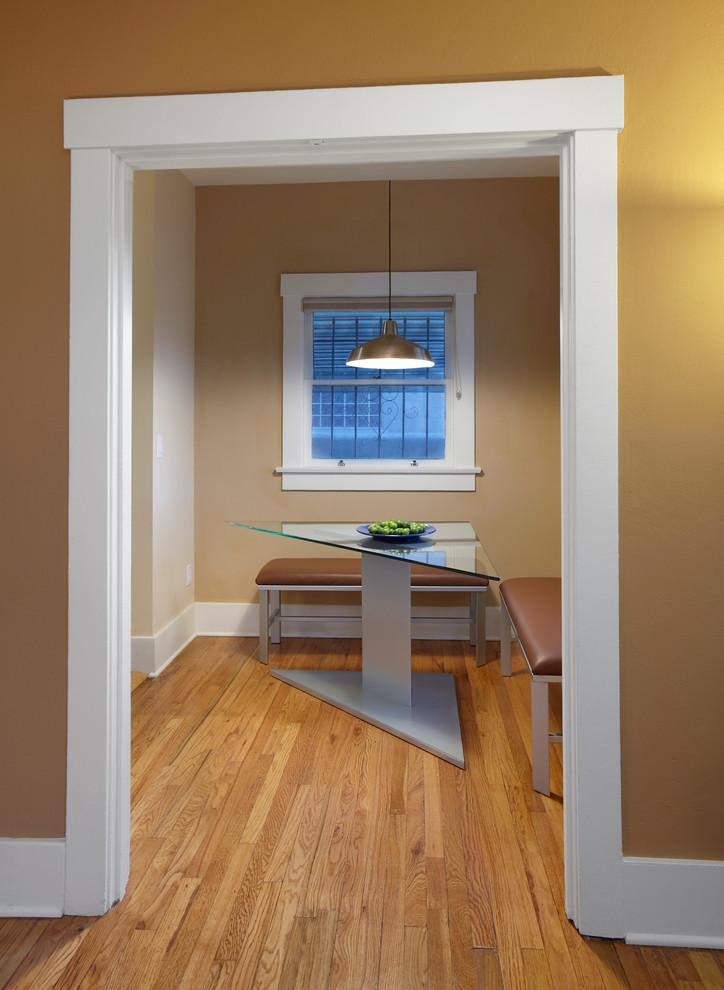 triangle dining table bench breakfast room corner doorway enclosed hardwood floor khaki painted wall neutral colors nook pendant light