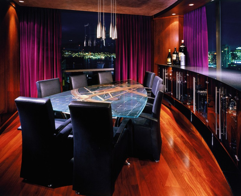 triangle dining table black countertop black dining chair curved cabinets curved wall floor to ceiling windows glass cabinet pendant light