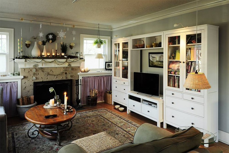 white cabinetry media wall area rug coffe table couch glass side table fireplace ceiling lamp