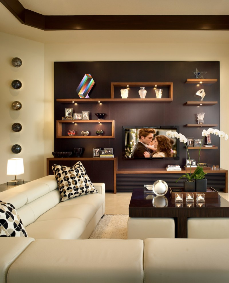 wooden wall shelves area rug coffee table marble floor ottomans sectional tray ceiling tv white leather wall deco table lamp
