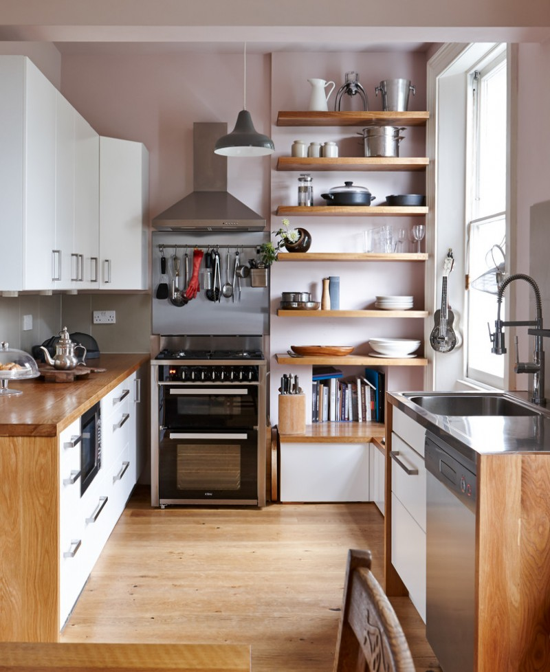 wooden wall shelves kitchen cooker hood hanging utensils stainless steel worktops storage timber floors utensil rail window bench