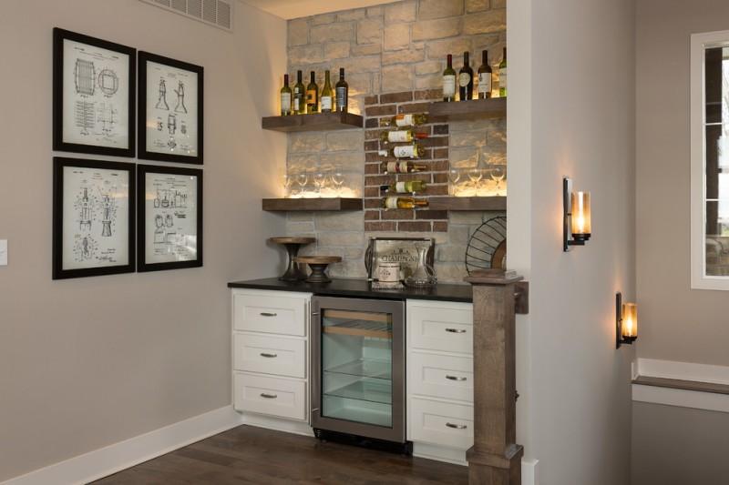 wooden wall shelves wine fridges beige wall brick wall dark hardwood floor gallery wall open shelves stone wall white shaker drawers