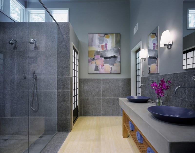 bamboo bathroom bamboo floor concrete walls windows shower glass door vanity blue sink bowls faucets mirror wall sconces artwork