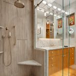 Bamboo Bathroom Beige Bathroom Wall Tiles Bamboo Floor Tile Shower Head Glass Doors Built In Shelves Mirror Wall Sconce Sink