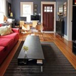 Black Rugs For Living Room Black Coffee Table Red Sofa Black Tv Table Door Eames Plywood Chairs Windows Artwork Wood Flooring