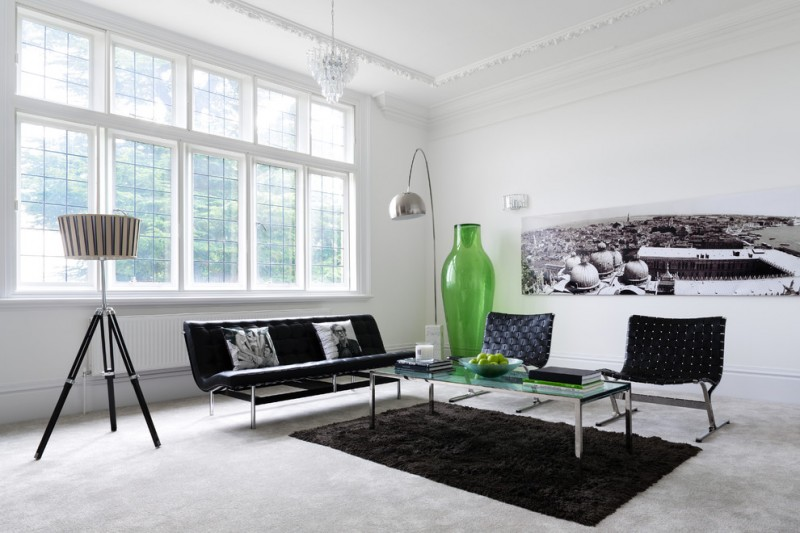 black rugs for living room floor light black chairs and bench chandelier crown molding glass coffee table green vase