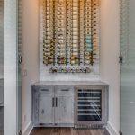 Brick Wall Wooden Floor Wine Storage Gray Cabinet Wine Racks Glass Door