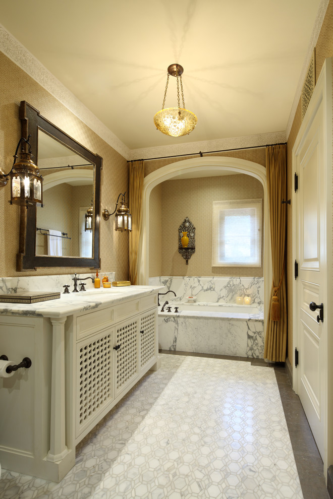 curtain tassels marble floor chandelier marble tub black faucet wall sconces vanity black framed mirrror undermount sink
