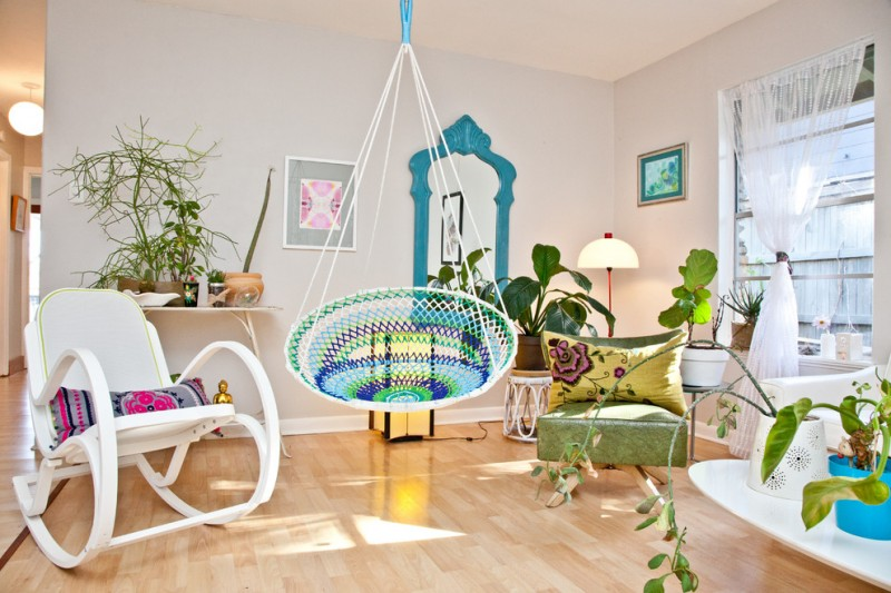 hanging papasan chairs colorful chair blue antique framed mirror white grandma chair green chair window white curtain indoor plants