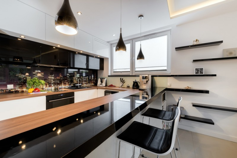 modern chic kitchen black and white cabinet peninsular kitchen wall mounted shelves windows black pendants and barstools