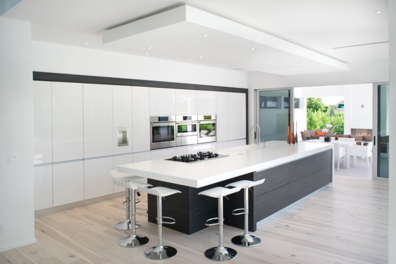modern chic kitchen white flat panel cabinet built in microwave and oven white barstools black kitchen island with white countertop