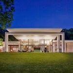 Modern Mansion Exterior Grass Yard White Painted Building Glass Walls Windows And Doors Lighting Fictures Outdoor Furniture Pieces