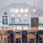 Nautical Kitchen Dark Blue Kitchen Island White Kitchen Cabinets Glass Windows And Door Wooden Barstools Wood Countertop