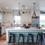 Nautical Kitchen White Kitchen Cabinets Blue Kitchen Island White Countertops Industrial Pendants Windows Wall Decor