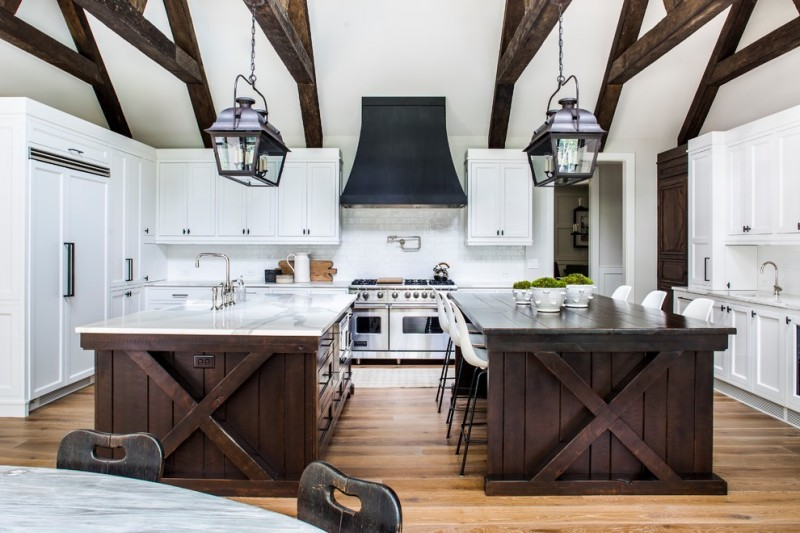 nautical kitchen wooden double island wood beams white ceiling white kitchen cabinets modern barstools pendants