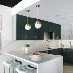 Peninsular Kitchen Gold Pendants Dark Grey Kitchen Cabinets White Tufted Barstools Hood Artworks Undermount Sink Gold Accents