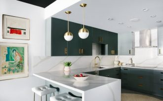 peninsular kitchen gold pendants dark grey kitchen cabinets white tufted barstools hood artworks undermount sink gold accents