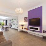 Purple Accent Walls Chandelier White Rooms Built In Shelves Table Lamp Brown Sofa Floor Lamp Glass Ceiling Skylight Beige Floor Tiles