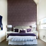 Purple Accent Walls Purple Flower Patterned Wallpaper White Bed Large Window With Blind Tufted Bench Headboard Nightstands