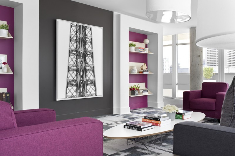 purple accent walls purple grey and white walls eames elliptical cocktail table from room & board grey sofa purple armchairs
