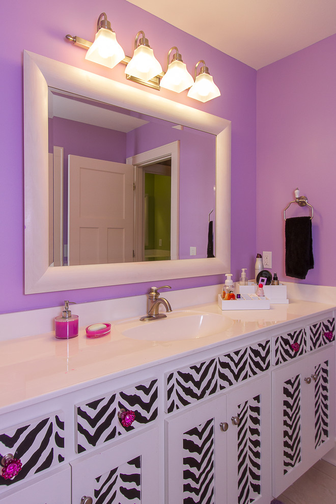 purple bathroom accessories purple walls wall sconces white framed mirror undermount sink towel ring black and white vanity with purple accents