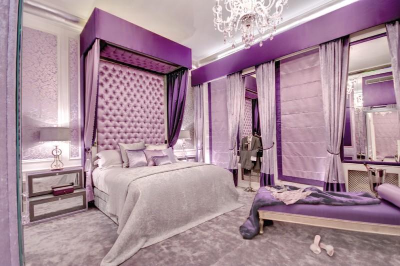 purple master bedroom crystals chandelier purple tufted headboard bed velvet bedding purple curtains purple bench carpet table lamps