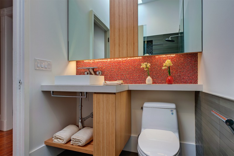 red bathroom accessories red backsplash recessed lighting under mirrored cabinet white sink and faucet wood towel shelves shower faucet