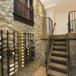 Stone Wall Chrome Wine Racks Staircase Railing Brick Floor Black Trim Window