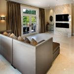Tan Living Room Marble Floor Sectional Sofa White Framed Glass Doors And Window Velvet Brown Curtains Wall Sconces Mirrors