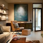 Tan Living Room Wall Mounted Shelves Beige Sofa Vintage Armchair And Footstool Blue Artwork Glass Framed Door Wooden Table Small Rug