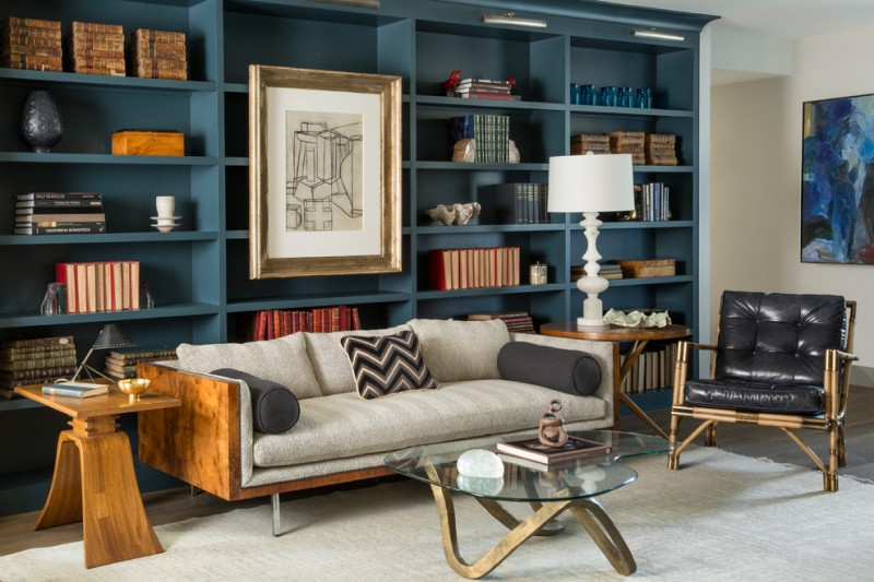 teal room teal cookshelves wood cushioned sofa art wall decor black leather chair wooden side table glass coffee table